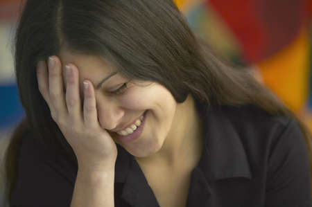 appendage: Young woman laughing LANG_EVOIMAGES