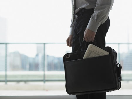 being the case: Young businessman holding his briefcase