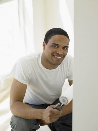 Young man painting his house Stock Photo - 16089549