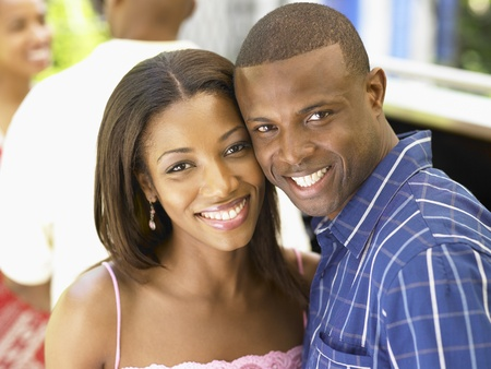 african american couple: Couple smiling together LANG_EVOIMAGES