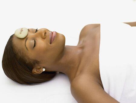 Young woman having a hot rock massage