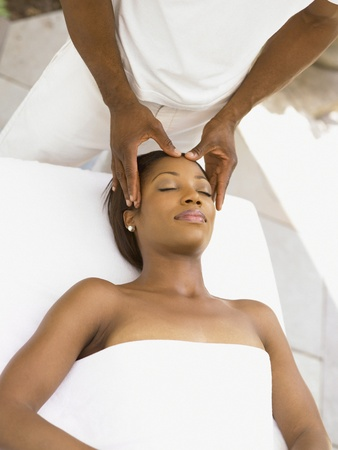 african american spa: Young woman having a scalp massage