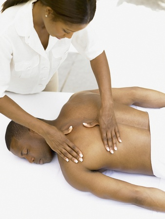 african american spa: Young man having a back massage