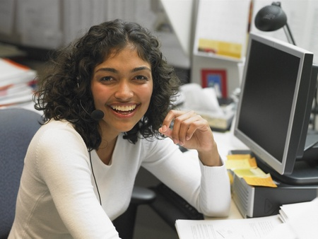 front desk: Businesswoman laughing at her desk
