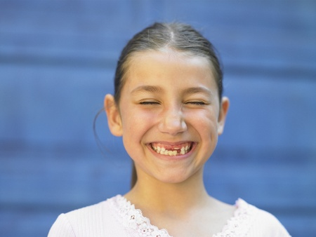 mischievious: Young girl grinning for the camera