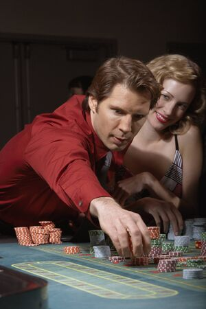 prevailing: Couple gambling in a casino