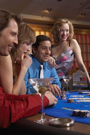 People playing at a blackjack table 写真素材