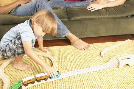 americal: Boy playing with toys on the ground