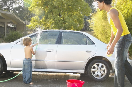 odd jobs: Father and son washing a car in a driveway LANG_EVOIMAGES