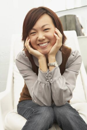 Young woman smiling for the camera Stock Photo - 16089698
