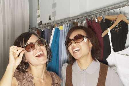 Young women trying on sunglasses Stock Photo - 16089704