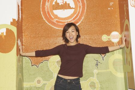 arms  outstretched: Young woman smiling for the camera