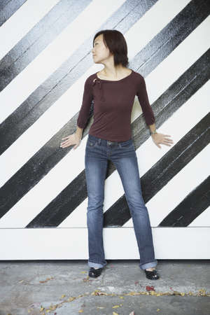 Young woman posing for the camera against striped wall Stock Photo - 16089708