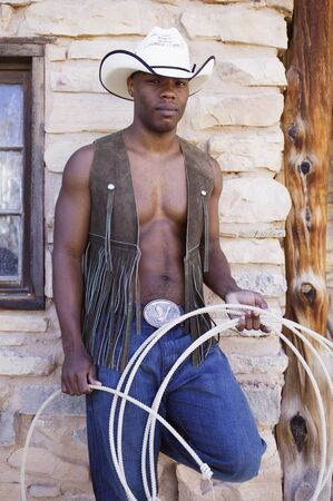 Young man in cowboy outfit posing for the camera Stock Photo - 16089765
