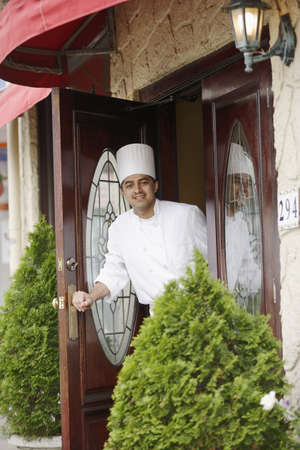 Chef walking into a restaurant Stock Photo - 16089819
