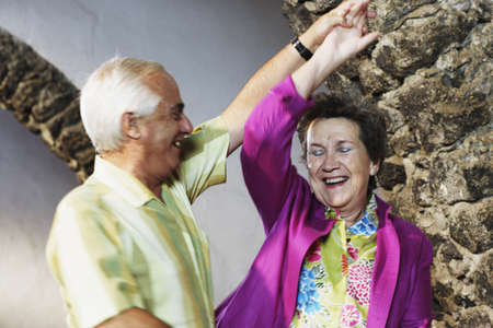 seventy two: Senior couple dancing together
