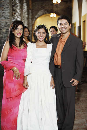 'evening wear': Family in evening wear smiling for the camera