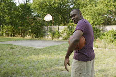 Man holding basketball Stock Photo - 16089866