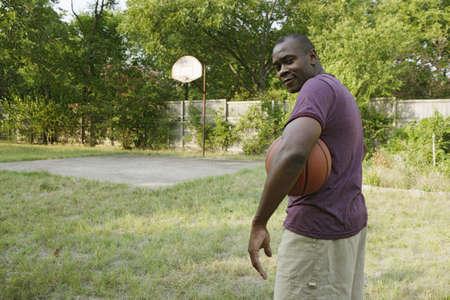 Man holding basketball Stock Photo - 16089866