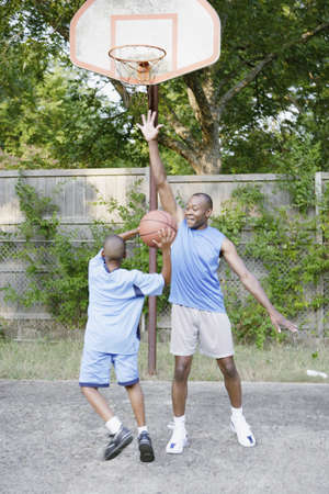 recreational sports: Father and son playing basketball
