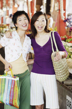 Two women shopping Stock Photo - 16089884