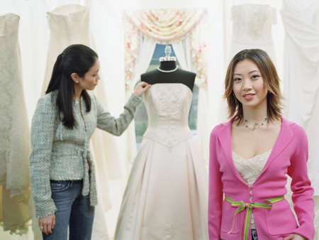 Young woman standing in a bridal boutique Stock Photo - 16089921