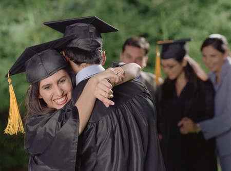 Graduates hugging Stock Photo - 16089953