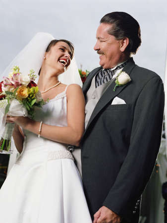 Bride posing for the camera with her father Stock Photo - 16089956