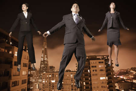 nite: Businesspeople floating above the city