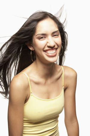 relishing: Young woman laughing LANG_EVOIMAGES