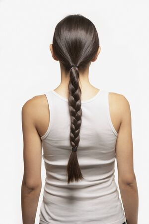back straight: Young womans braid LANG_EVOIMAGES