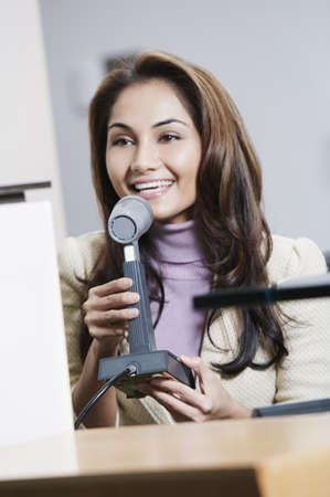 declaring: Young woman talking into a microphone