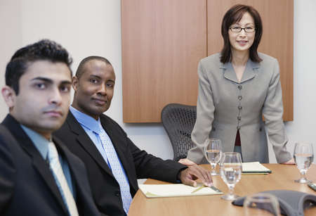 Businesswoman standing at conference table Stock Photo - 16090050