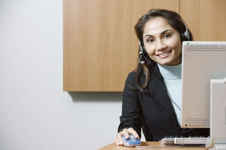Businesswoman wearing a headset at work