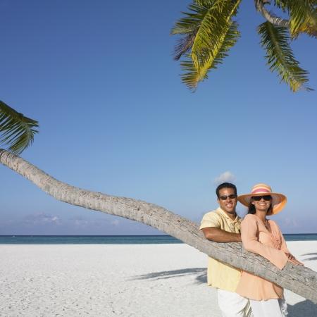 honeymooner: Couple posing at the beach