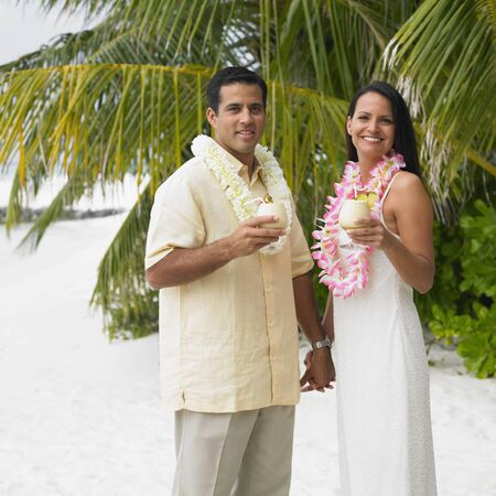 honeymooner: Couple having tropical drinks