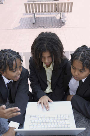 3 persons only: Students using a laptop