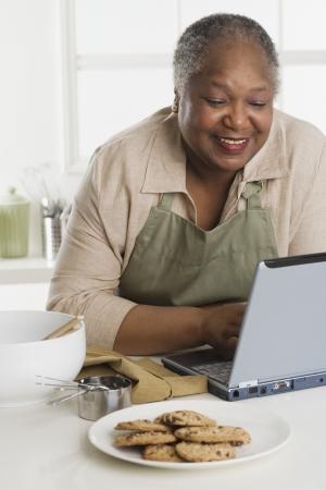 Senior woman using a laptop Stock Photo - 16090151