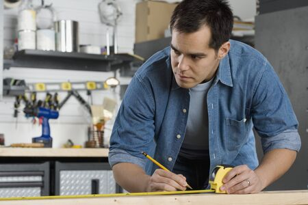 Carpenter making marks on wood Stock Photo