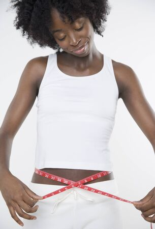 Young woman measuring her waist Stock Photo - 16090162