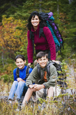 Family camping in forested area Stock Photo - 16090210