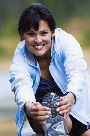 exerting: Female athlete stretching