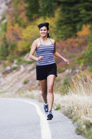 exerting: Female athlete jogging