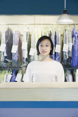 Asian drycleaner standing behind counter, Edmonds, Washington, United States Stock Photo - 16090269