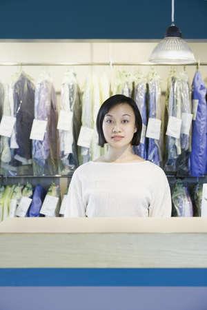 edmonds: Asian drycleaner standing behind counter, Edmonds, Washington, United States