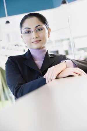 edmonds: Asian businesswoman leaning on counter, Edmonds, Washington, United States