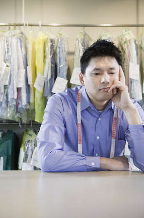 wearying: Bored Asian dry cleaner, Edmonds, Washington, United States LANG_EVOIMAGES