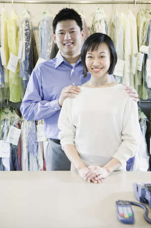 Asian male and female drycleaners smiling, Edmonds, Washington, United States Stock Photo - 16090274