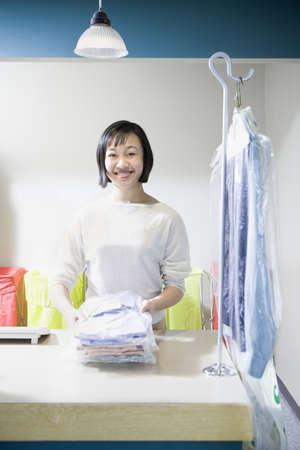 folding camera: Happy Asian drycleaner, Edmonds, Washington, United States