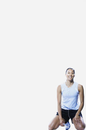 edmonds: Woman in sportswear kneeling, Edmonds, Washington, United States